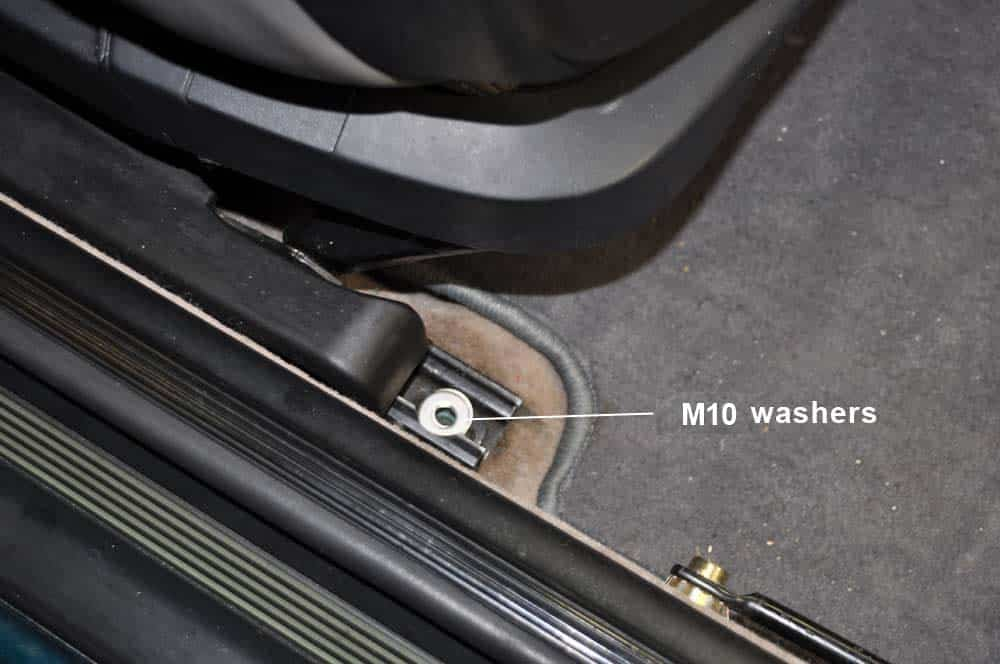 Stack M10 washers on rear seat mounting bolts.