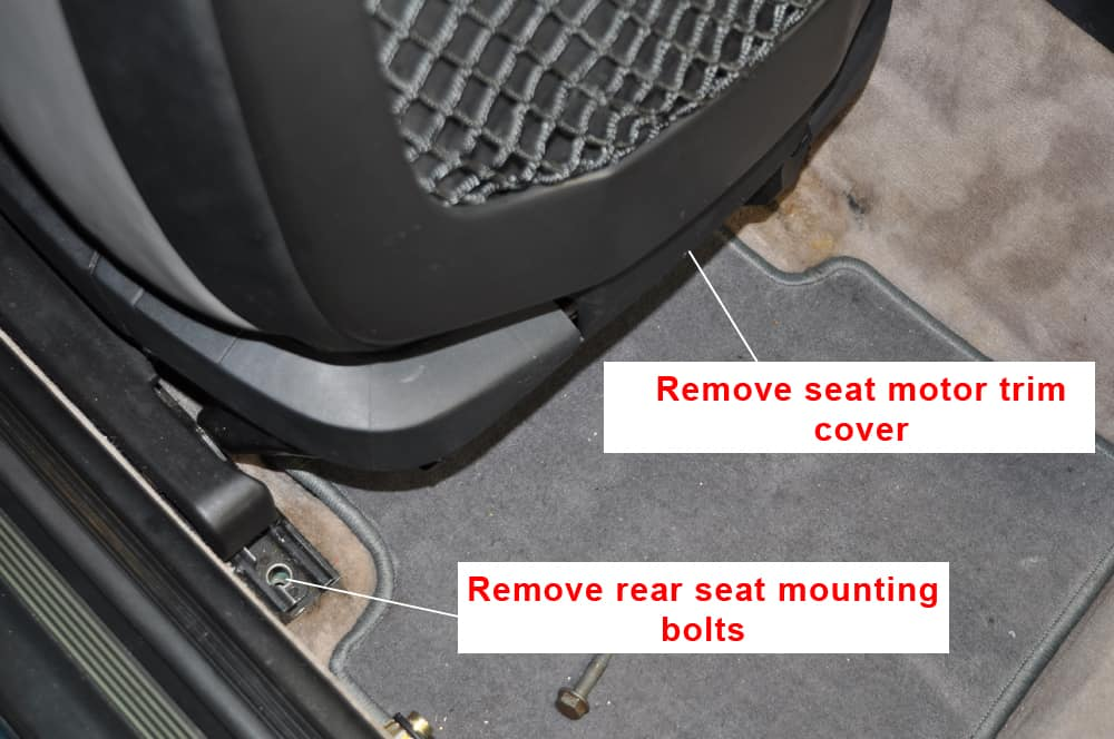 BMW E36 Racing Harness - Remove the seat motor trim cover.