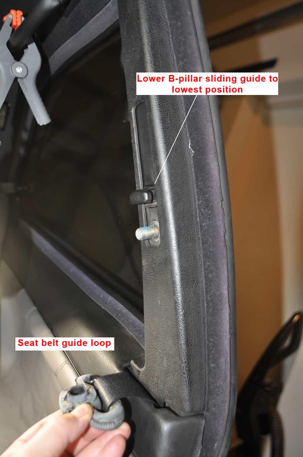 BMW E36 Racing Harness - Remove the B-pillar seatbelt guide nut.