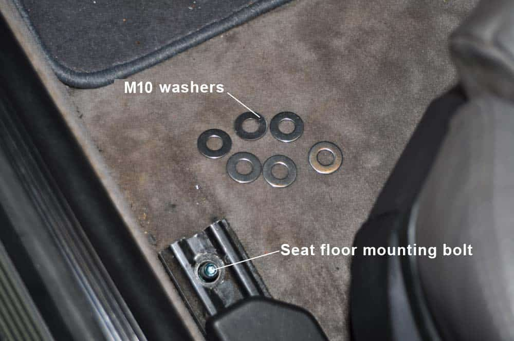 BMW E36 Racing Harness - Install M10 washers on front seat mounting bolt.