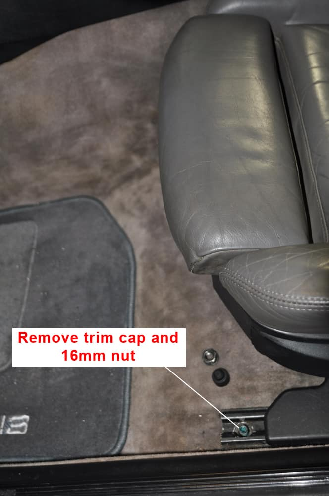 Remove the 16mm nuts on the front of the seat.