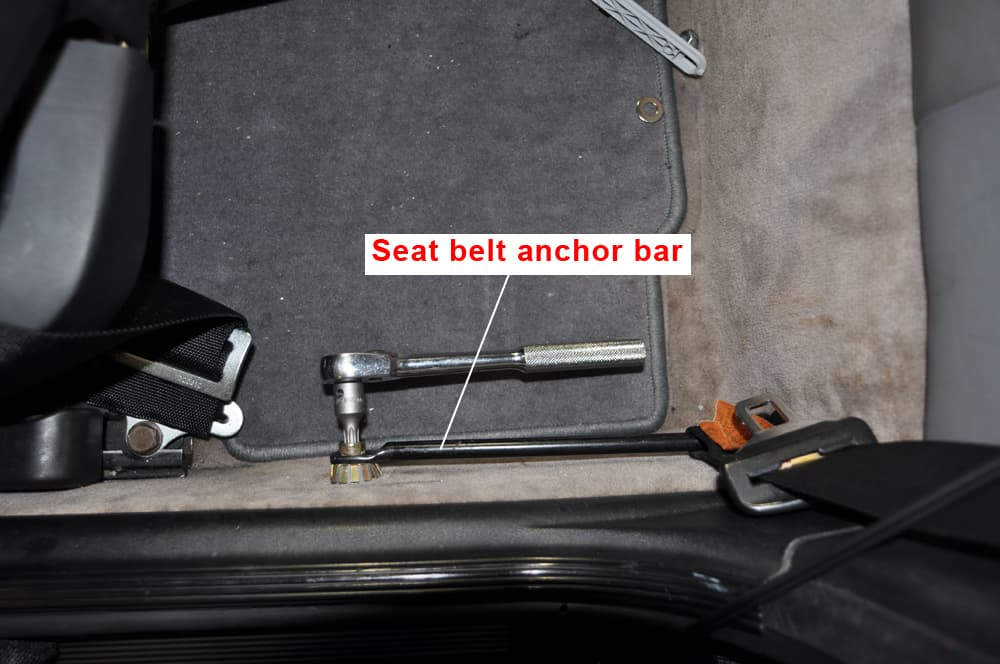 Remove the seatbelt anchor bar.