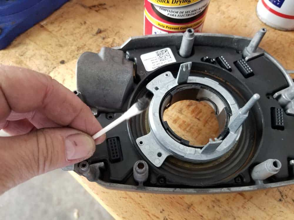 bmw e60 steering angle sensor repair - Notice the dirt and grime removed from the sensor disk.