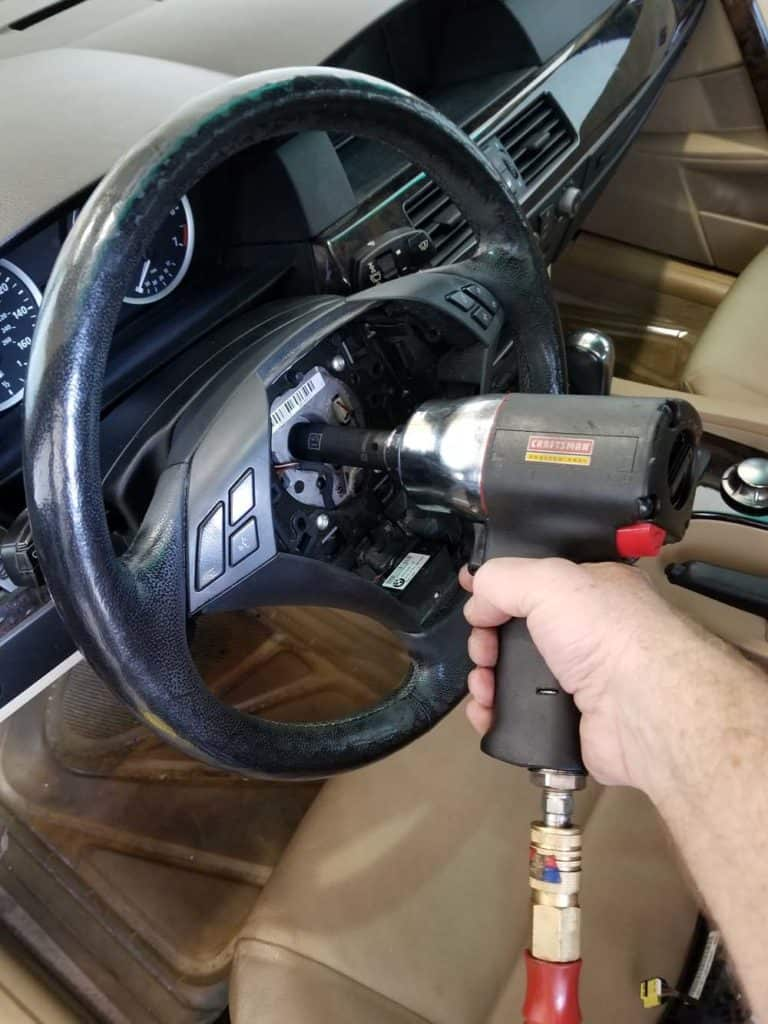 bmw e60 steering angle sensor repair - remove the steering wheel with a 15mm socket and impact wrench.