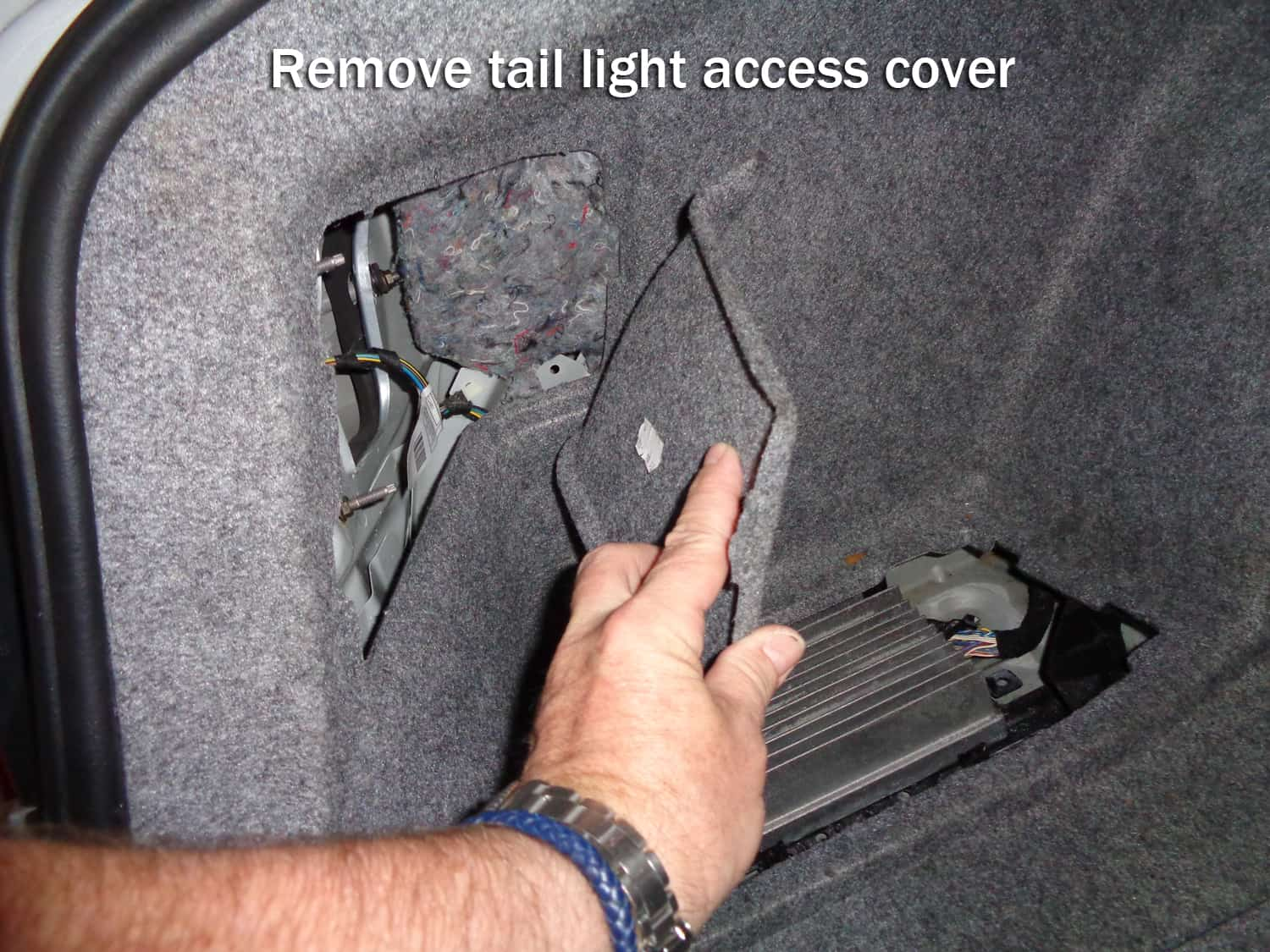 bmw e90 amplifier water damage repair - remove taillight access cover