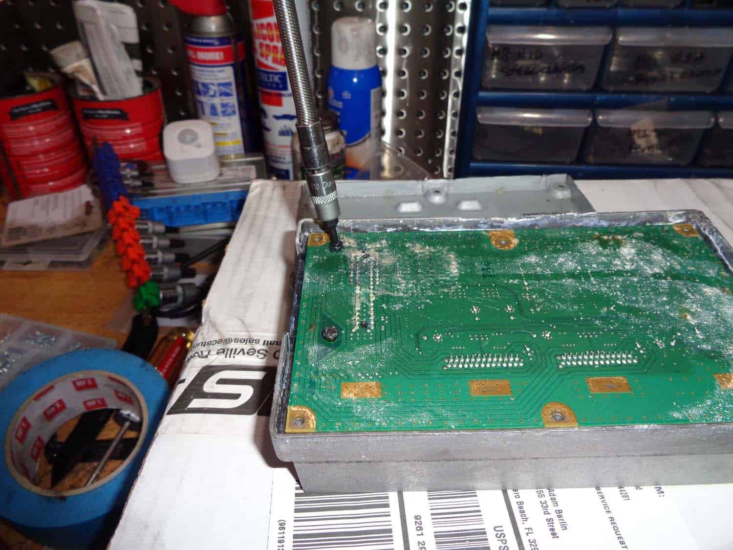 bmw e90 amplifier water damage repair - remove the circuit board mounting screws