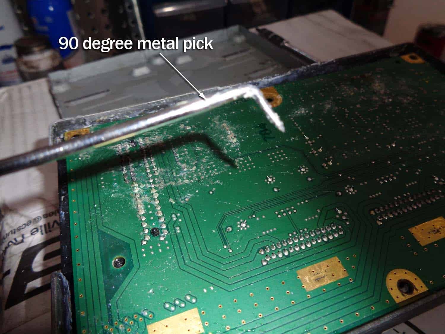 bmw e90 amplifier water damage repair - use a metal pick to remove the circuit board