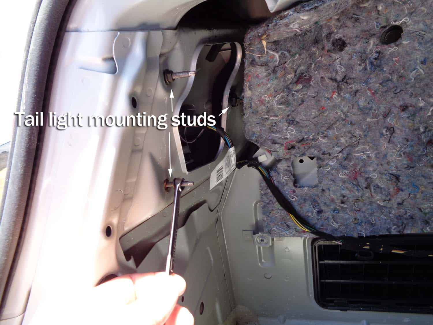 BMW E90 Trunk Leak - remove the tail light mounting nuts