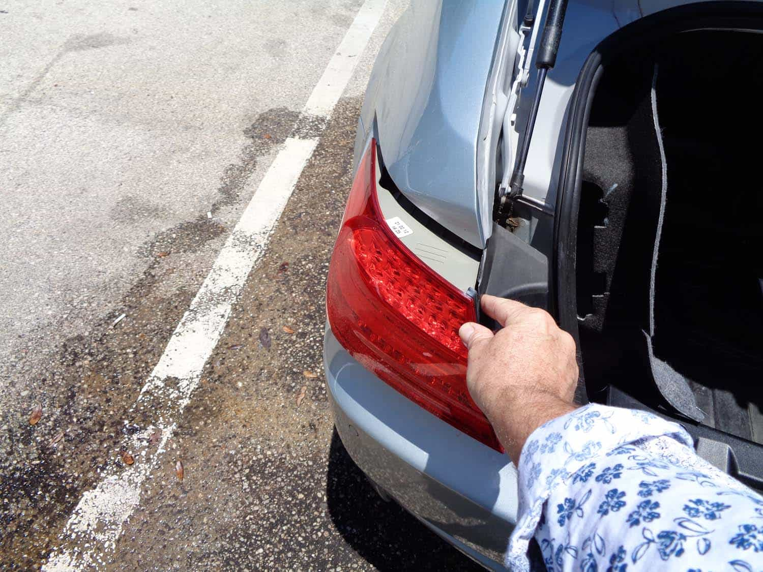 BMW E90 Trunk Leak - remove the tail light from vehicle