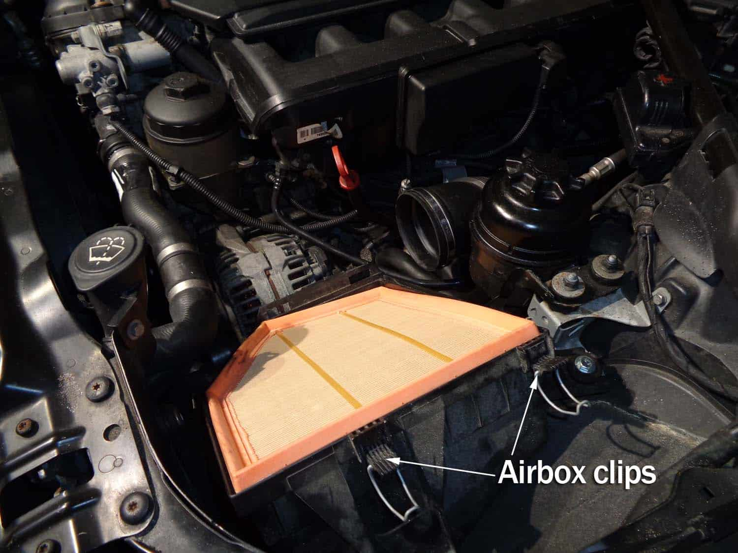 bmw e60 intake boot repair - unclip top of air box and remove