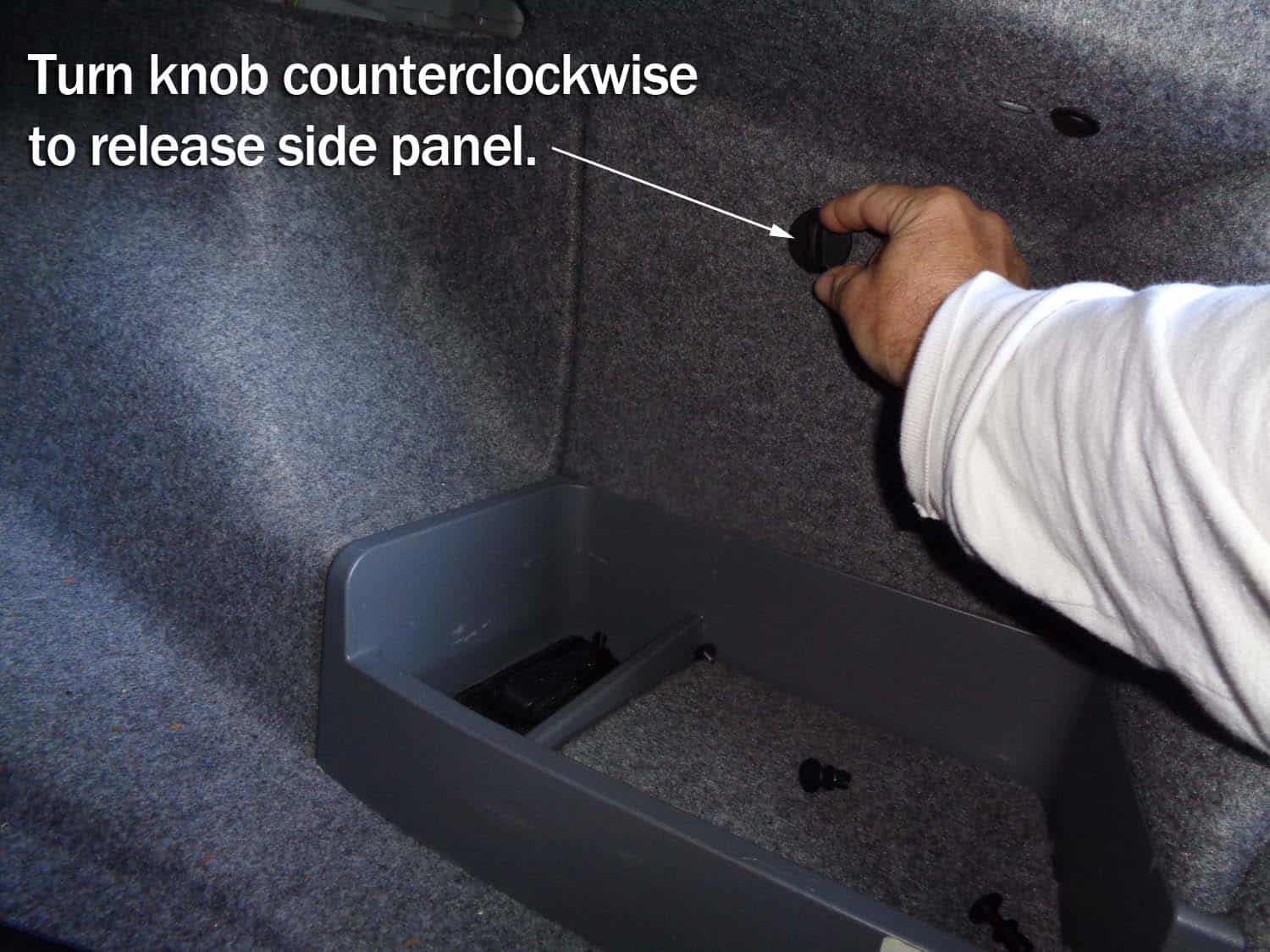 Remove the right trim panel from inside the trunk