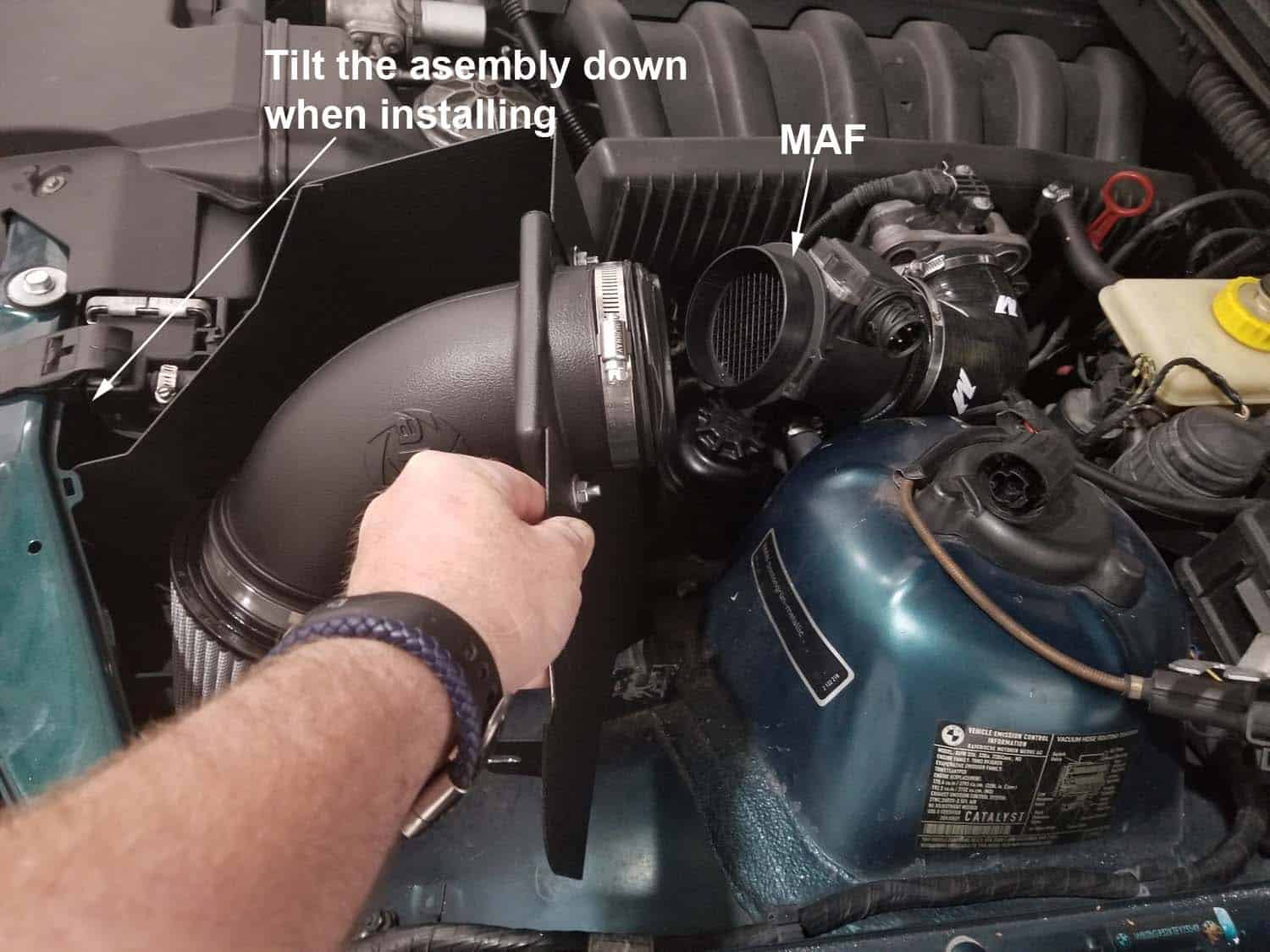 BMW E36 cold air intake - install the cold air intake into the vehicle