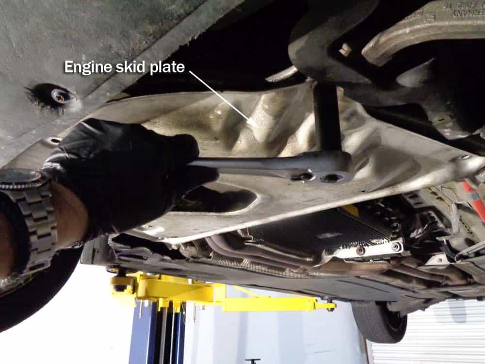 BMW E60 oil level sensor repair - remove the engine skid plate