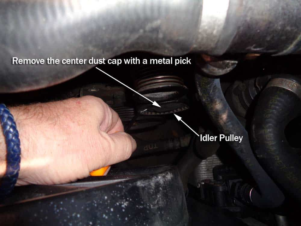 bmw e60 tensioner pulley replacement - remove the idler pulley dust cap