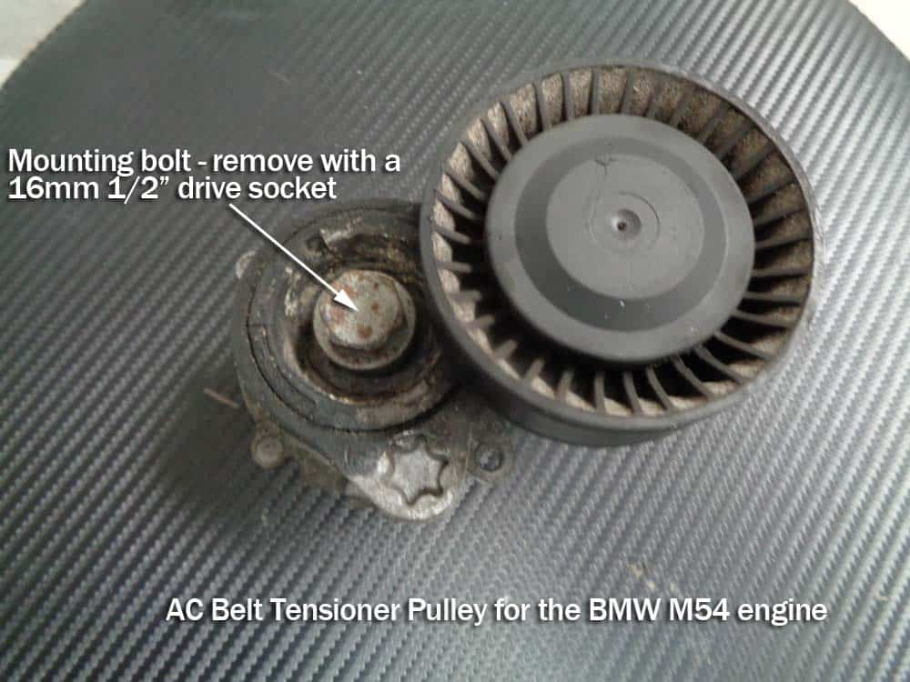 bmw e60 tensioner pulley replacement - - remove the AC tensioner mounting bolt with a 16mm socket wrench