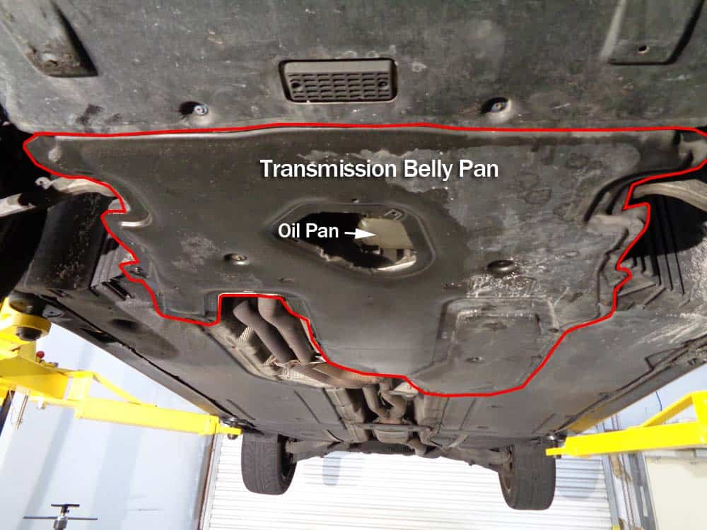 BMW E60 oil level sensor repair - remove the rear belly pan from bottom of the vehicle