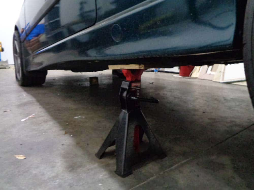 """bmw jacking and supporting - Place the jack stands 12"""" from the rear wheels if there are no side jack pads"""