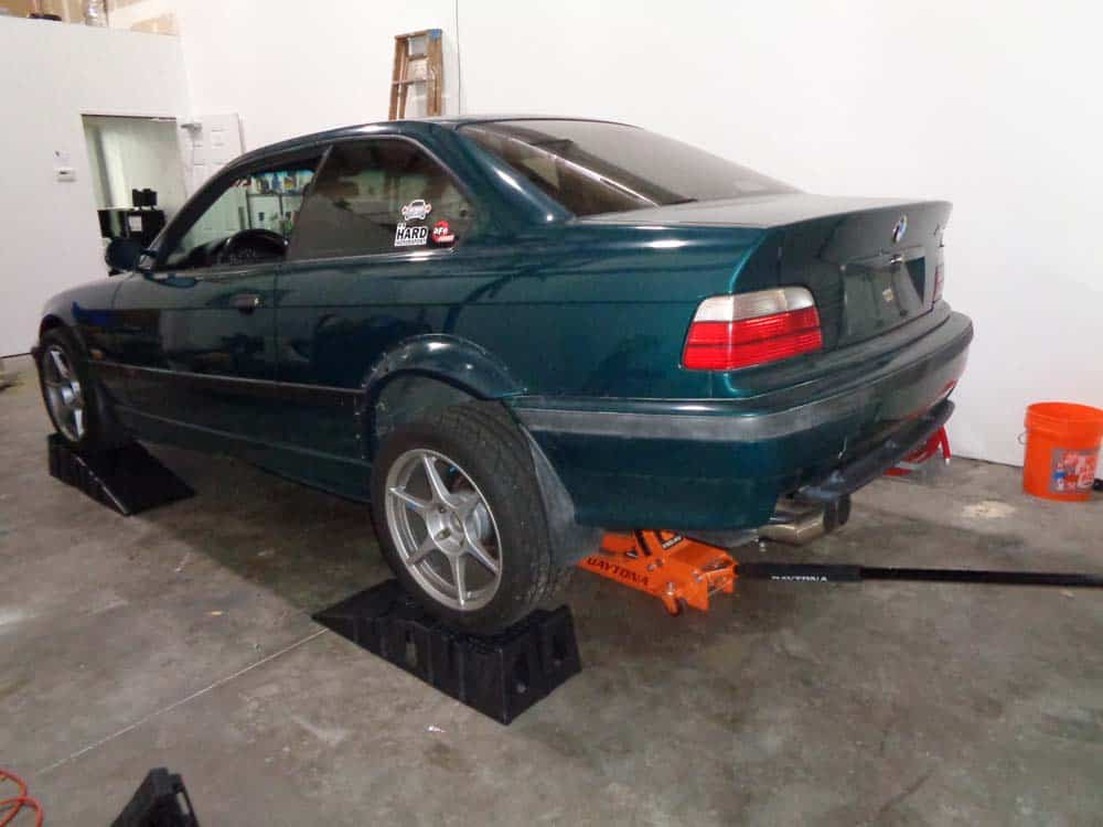 bmw jacking and supporting - gently lower the rear of the car on the wheel ramps