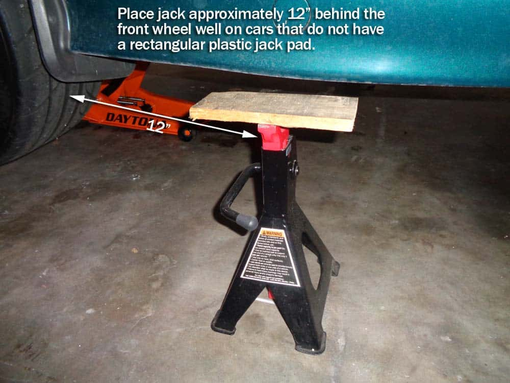 """bmw jacking and supporting - Always position jack stand 12"""" behind front wheels if they don't have side jack pads."""