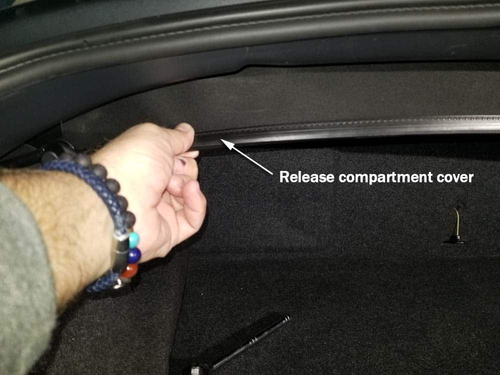 BMW E85 rear shock replacement - release the compartment cover