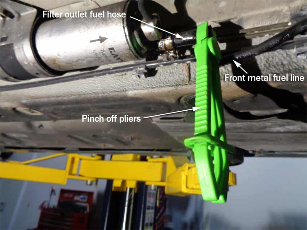 Clamp off the front furl line(s) so fuel doesn't spill out of the filter