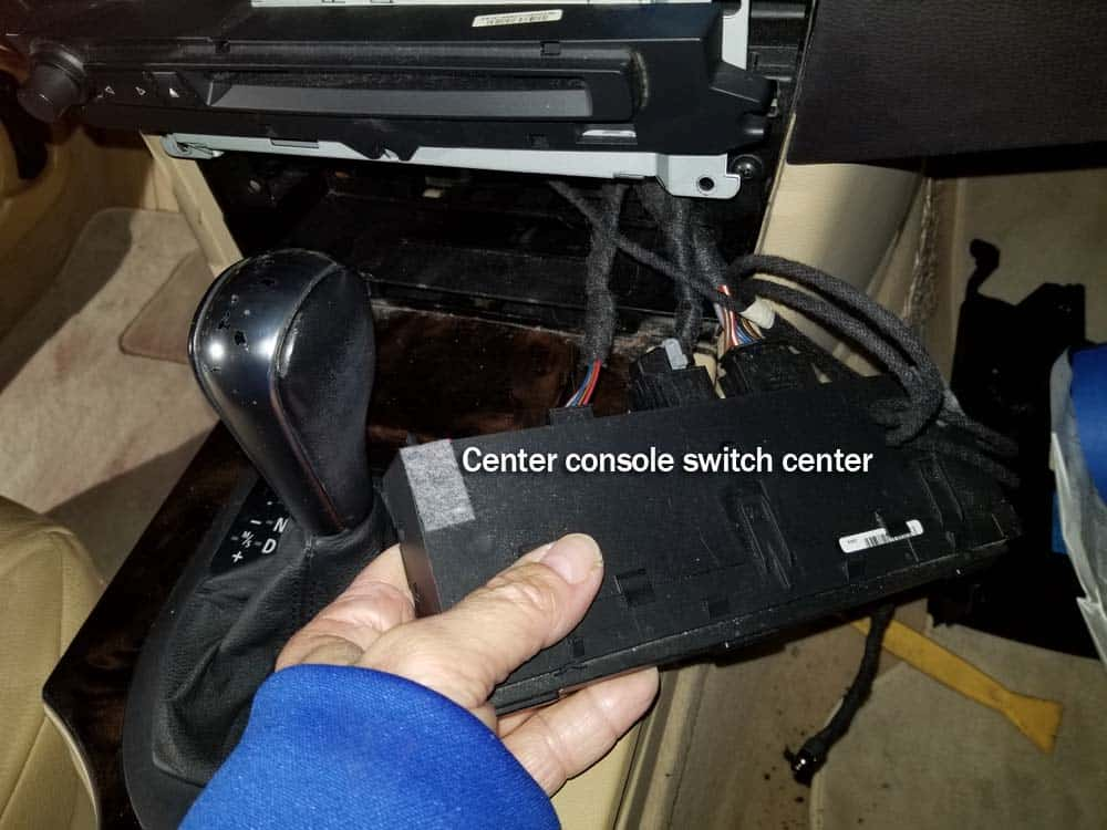 bmw auxiliary port - Remove the center console switch center