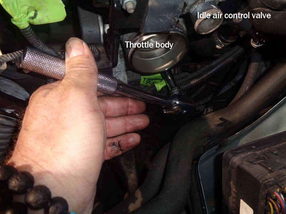 Remove the lower throttle body mounting bolt