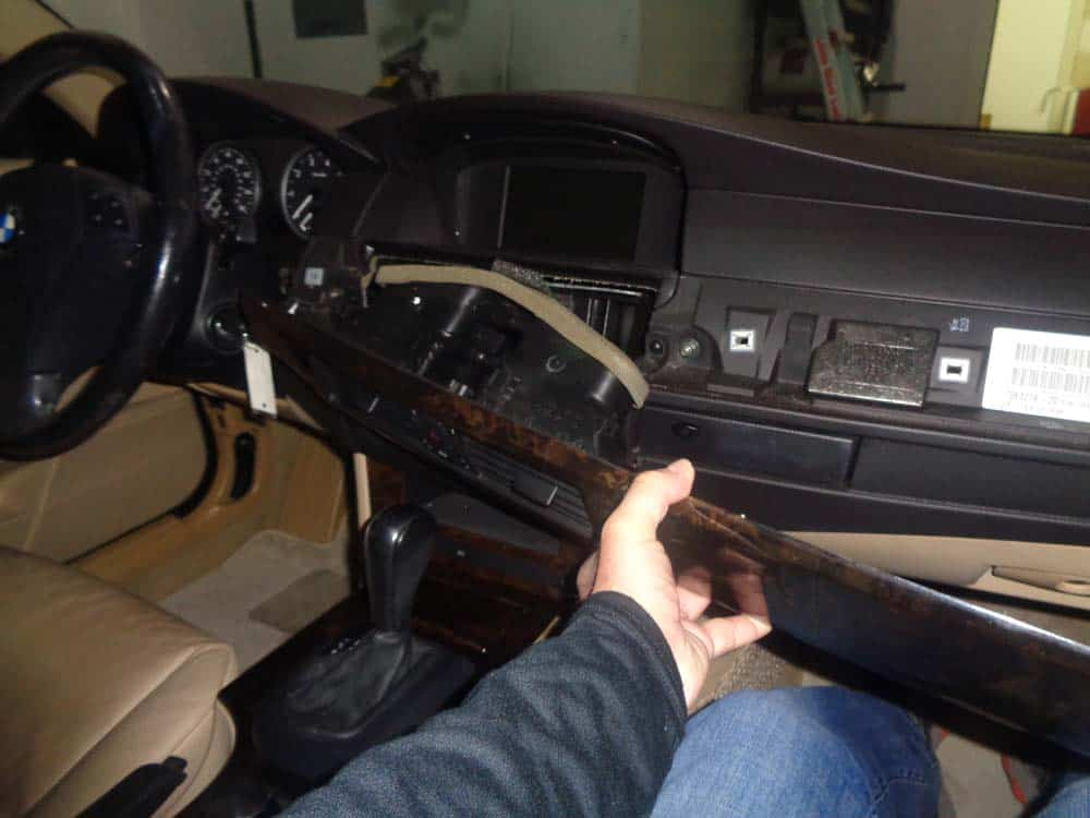 bmw auxiliary port - Remove the dash trim from the dashboard