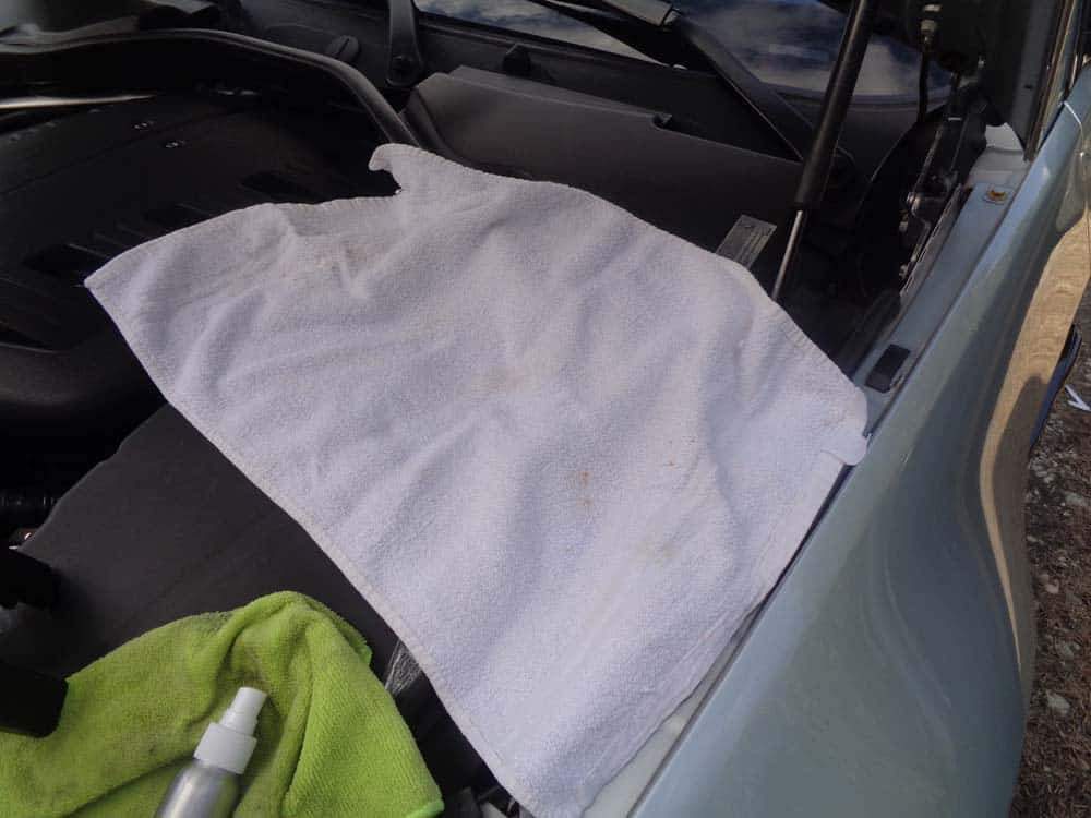 BMW dent repair - If working in the engine comportment, lay a towel down to avoid getting glue in the engine