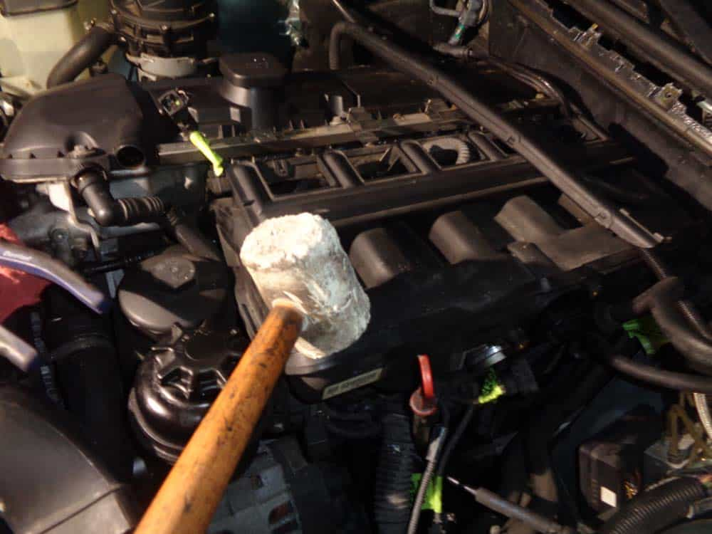 BMW E46 intake manifold - Tap the intake manifold gently with a rubber mallet if it is stuck and wont pull loose from the engine head.