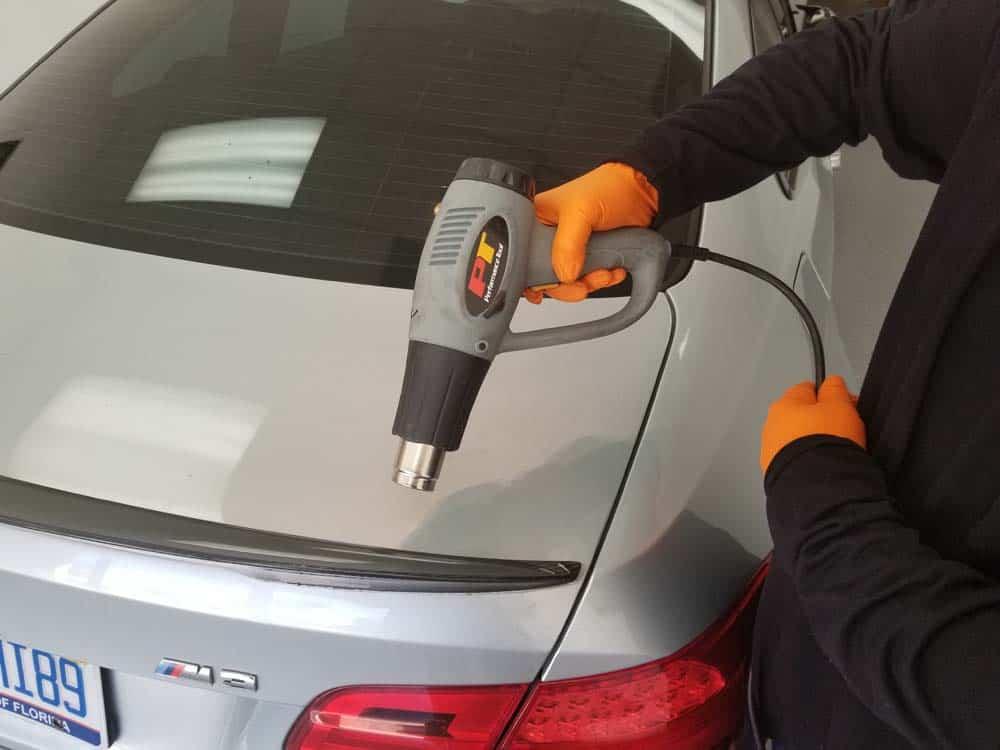 rear spoiler repair - use a heat gun to soften the old adhesive