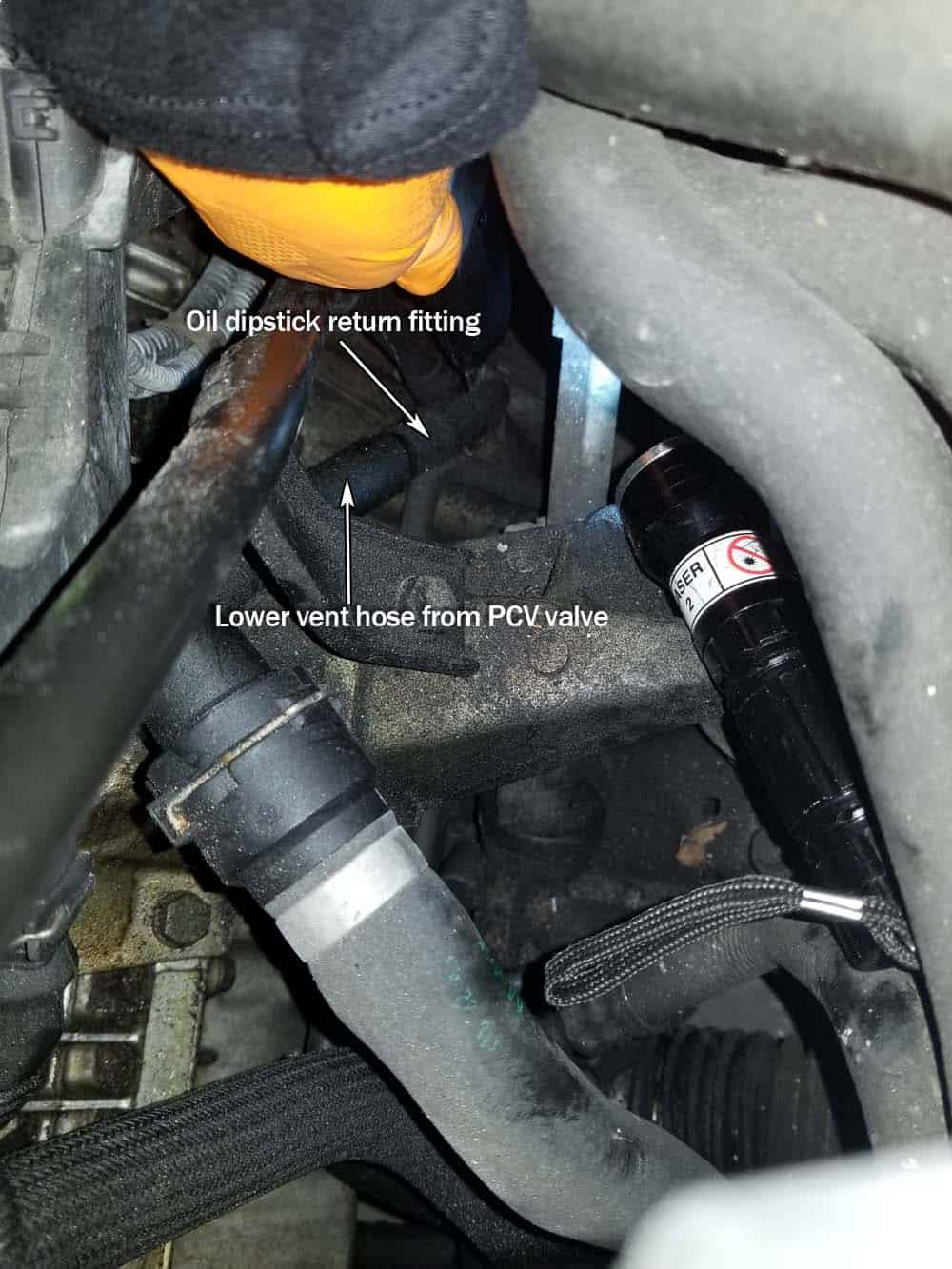 bmw e46 pcv valve replacement - Use a little engine oil to help lube the dipstick fitting so the lower vent hose slides on.