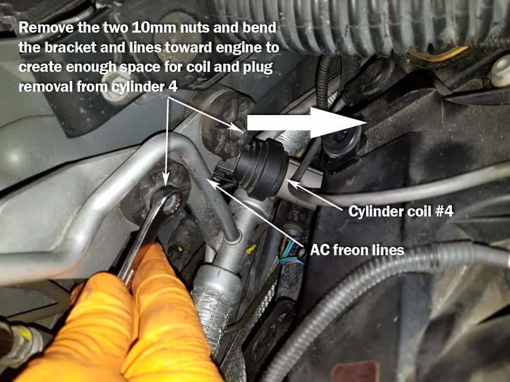 BMW N62 engine tune up - Cylinder 4 may require loosening the AC freon line bracket to gain access to the ignition coil.