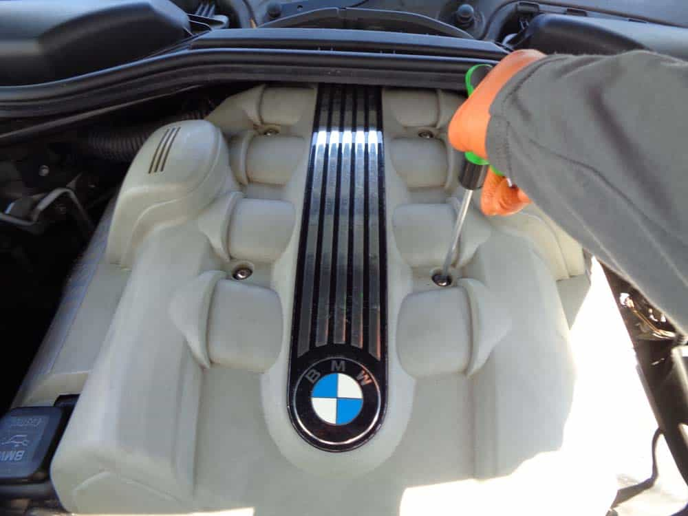 BMW N62 engine tune up - remove the engine cover mounting bolts