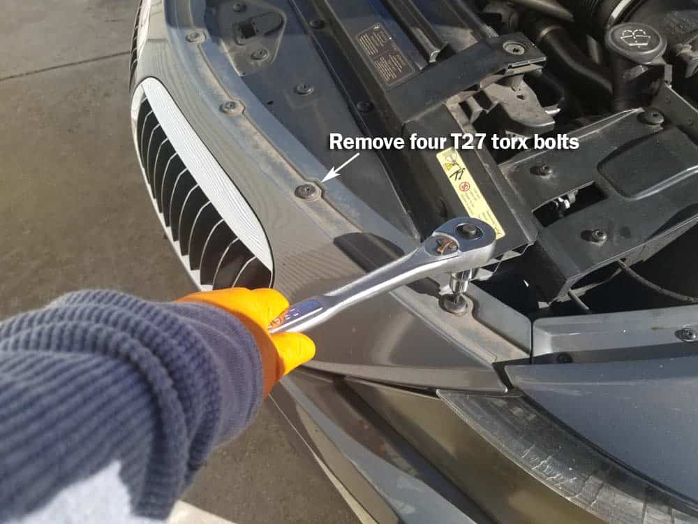bmw 645ci grille replacement - Remove the T27 torx bolts anchoring the top of the bumper.