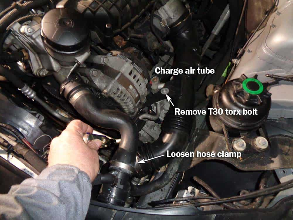 Unsnap the locking ring that connects the turbo charge air tube to the throttle body with flat blade screwdriver. Loosen hose clamp and remove T30 torx bolt anchoring tube to engine. Remove tube (a flat blade screwdriver helps remove from throttle body).