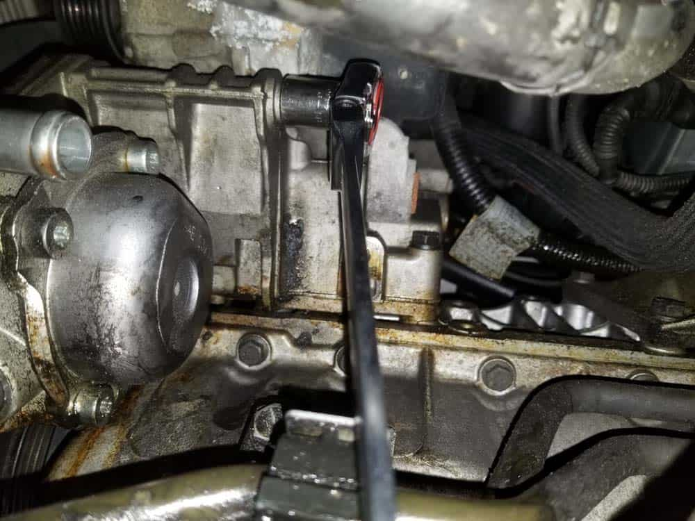 remove rear mounting bolt