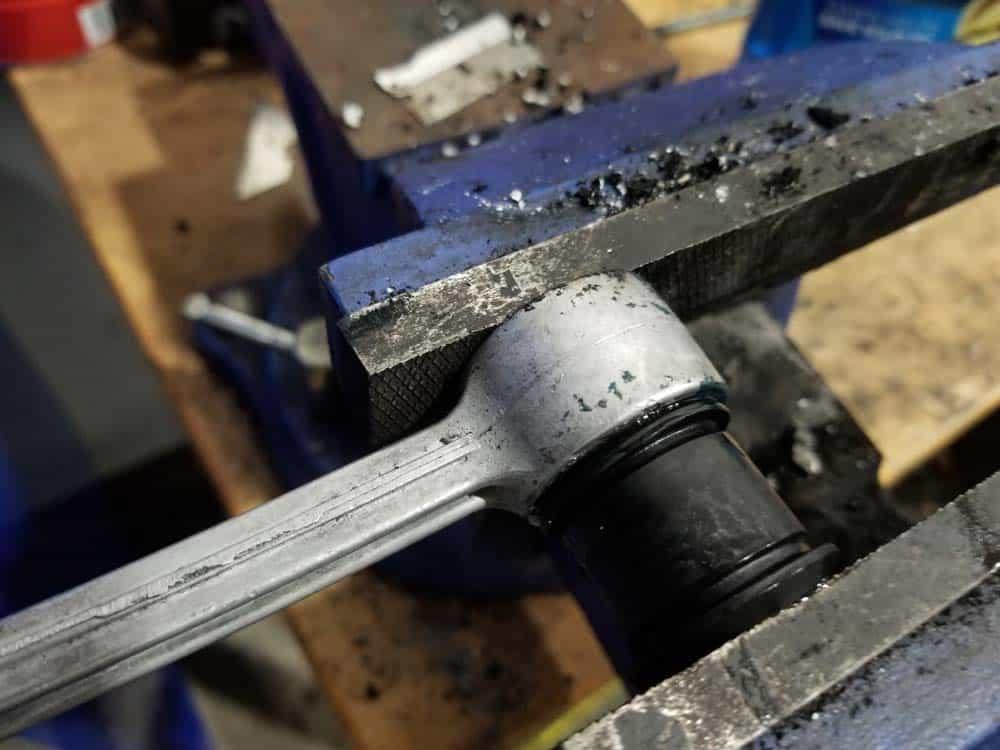 bmw e36 sway bar bushing replacement - press bushing with vice