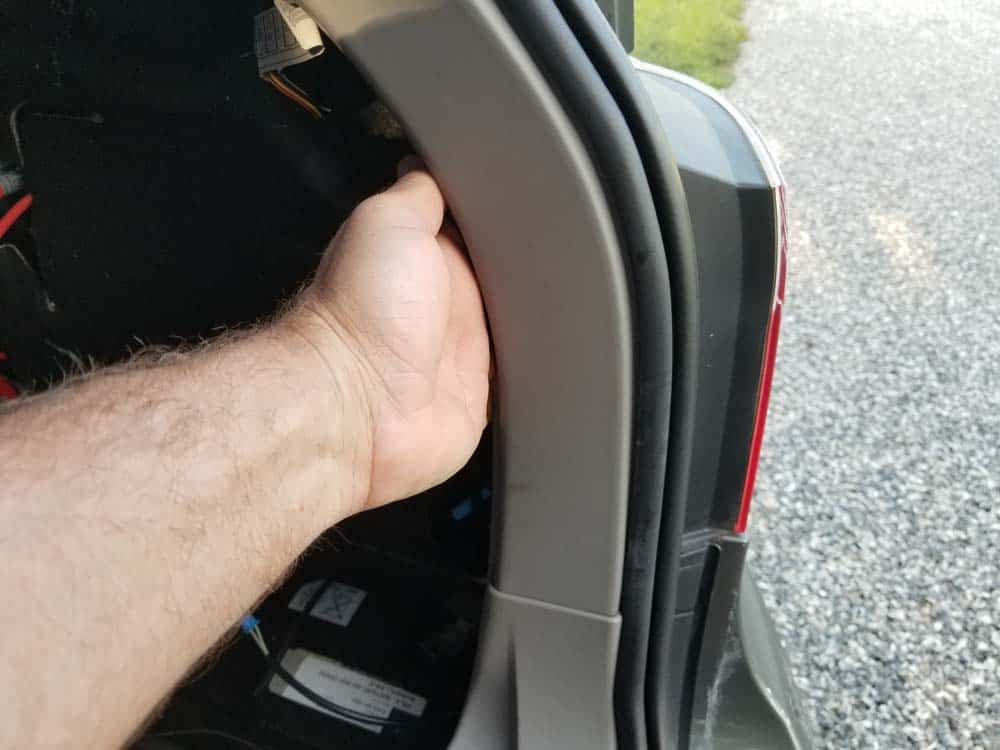 bmw e61 trunk leak - unsnap the bottom portion of the trim