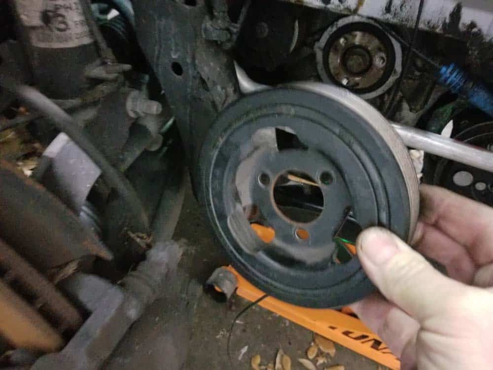 MINI R56 crankshaft pulley removed from engine