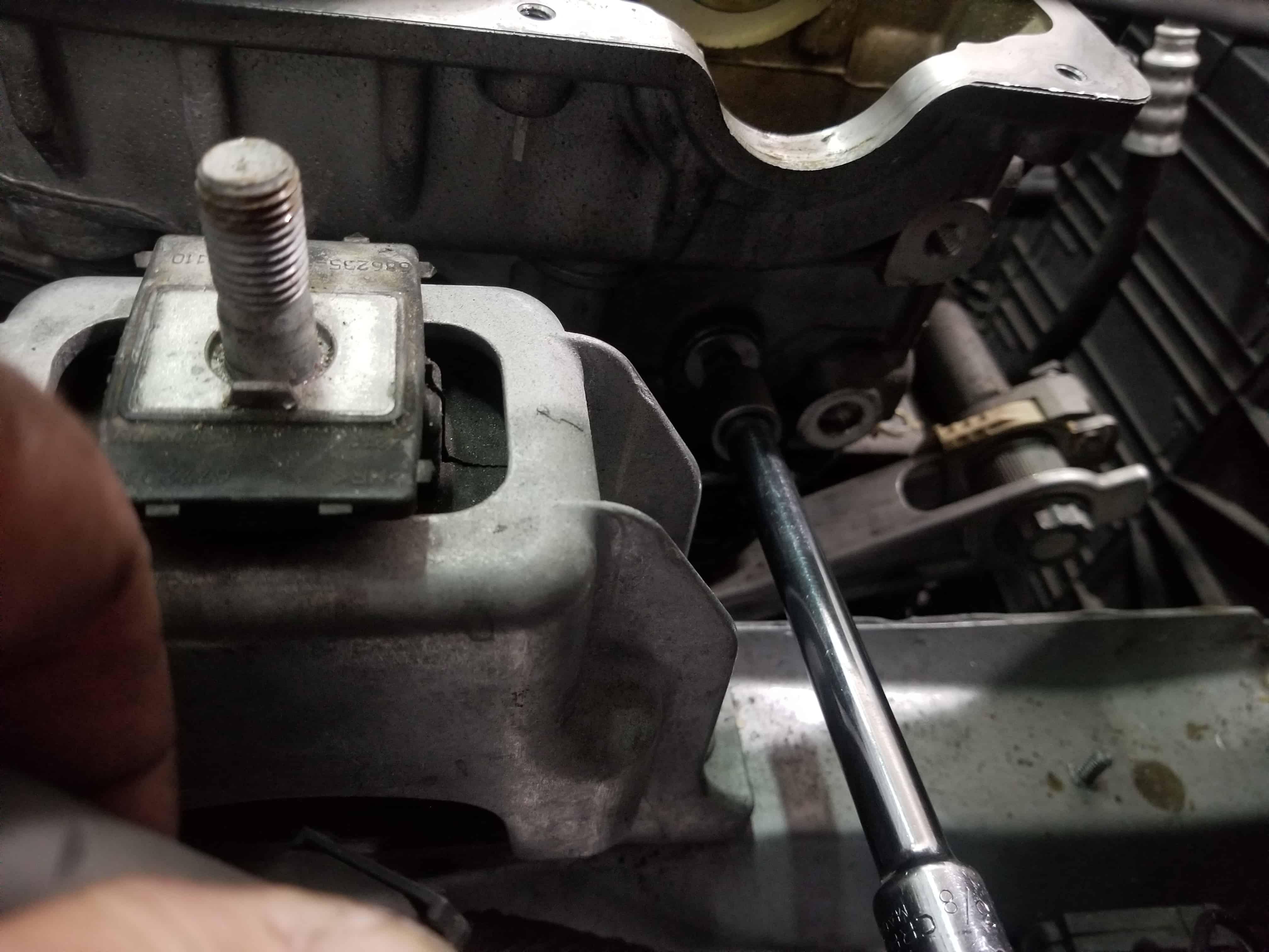 Remove top bearing bolt