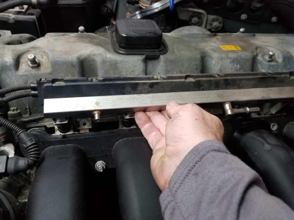 BMW E60 valve cover repair - remove fuel rail from car