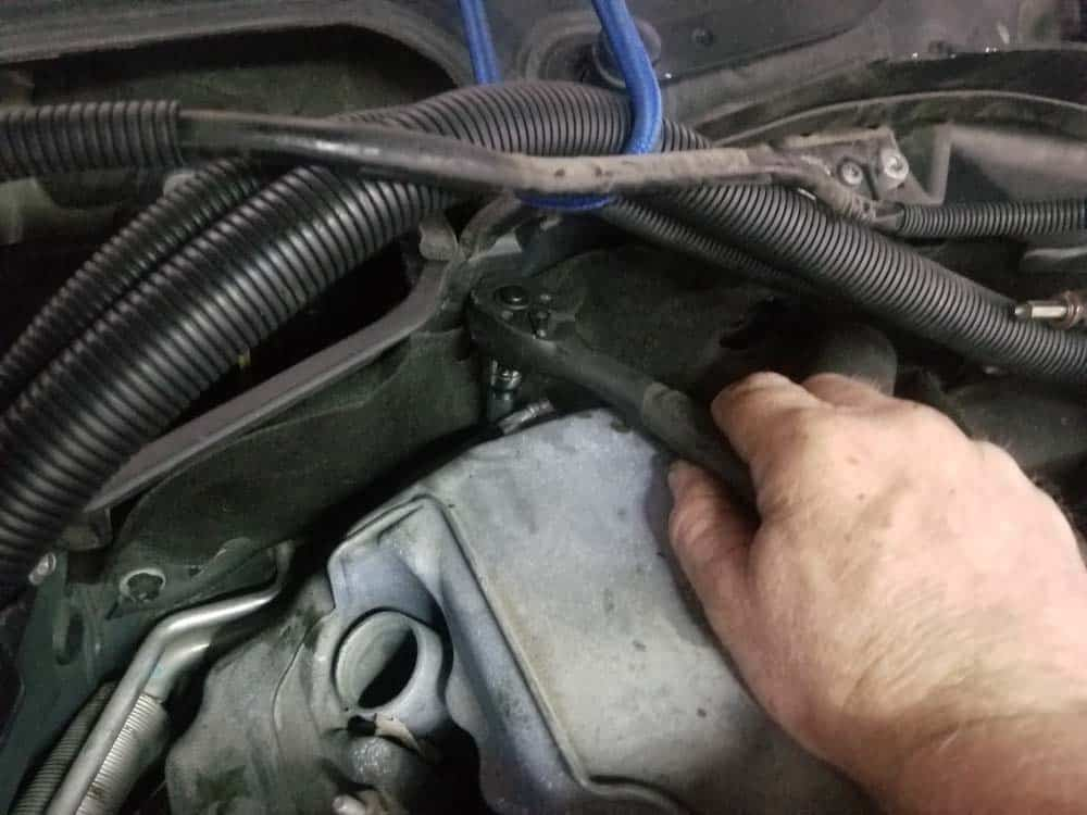 BMW E60 valve cover repair - rear mounting bolts are hidden.