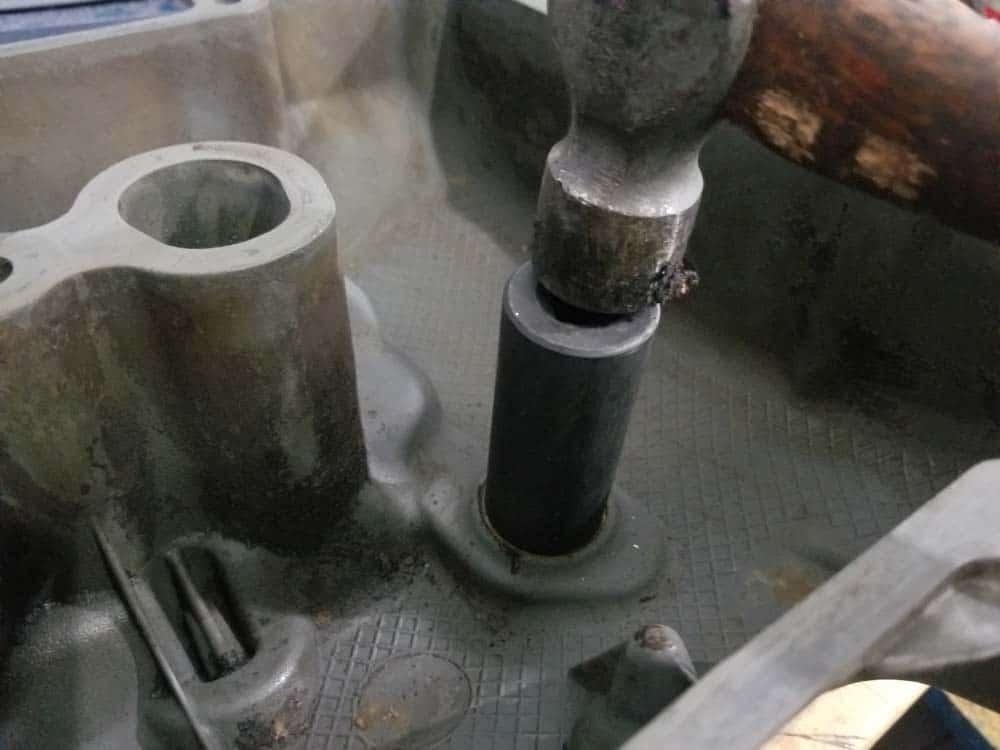 Use 24mm socket to punch out old eccentric valve sensor gasket