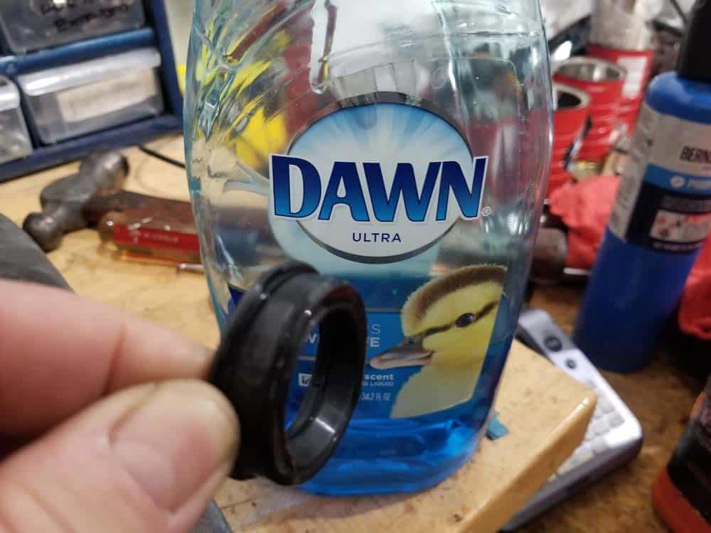 Use dish detergent to lubricate new gasket