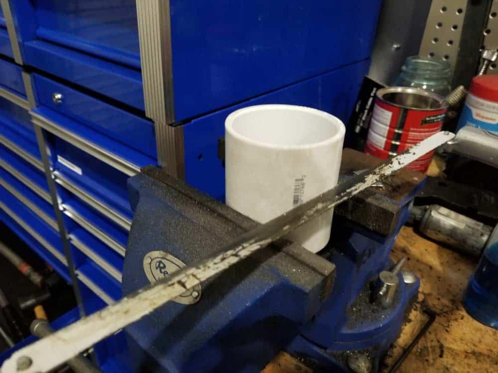 "Cut a 2"" PVC coupling to make crankshaft seal tool"