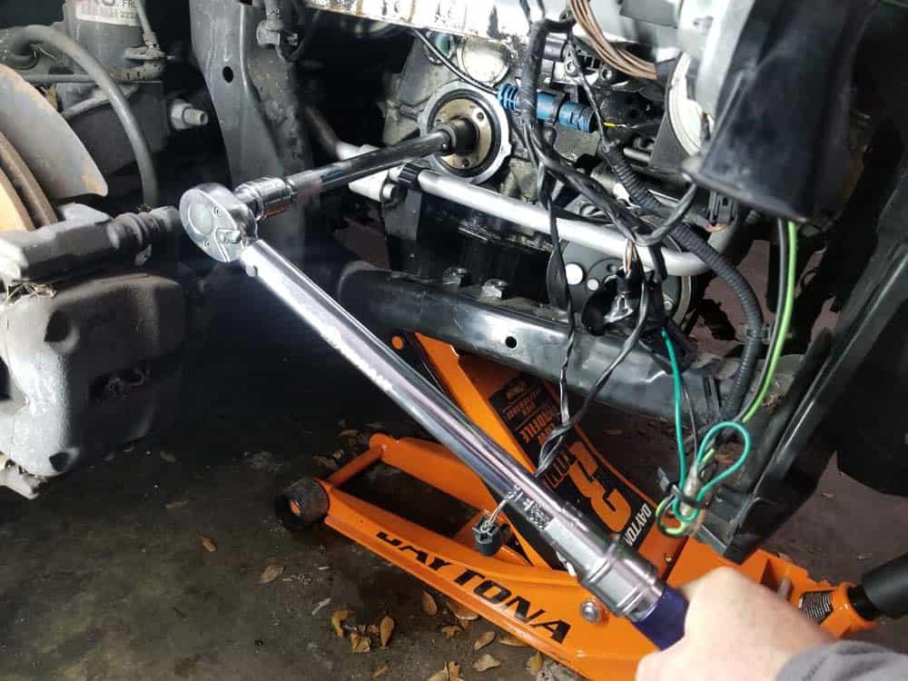 Torque the crankshaft hub bolt, then turn another 180 degrees.