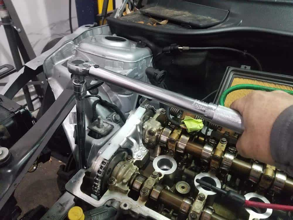 Check the torque of the front engine mount bolt