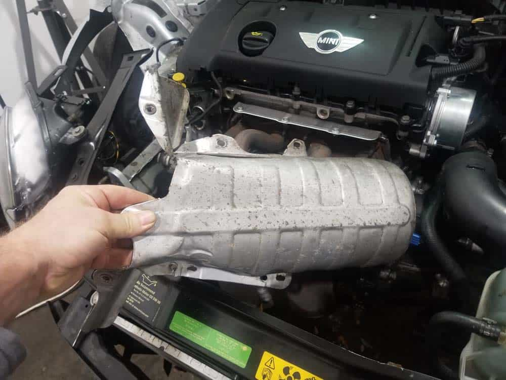 MINI R56 oil filter housing leak repair - remove the lower heat shield from the vehicle