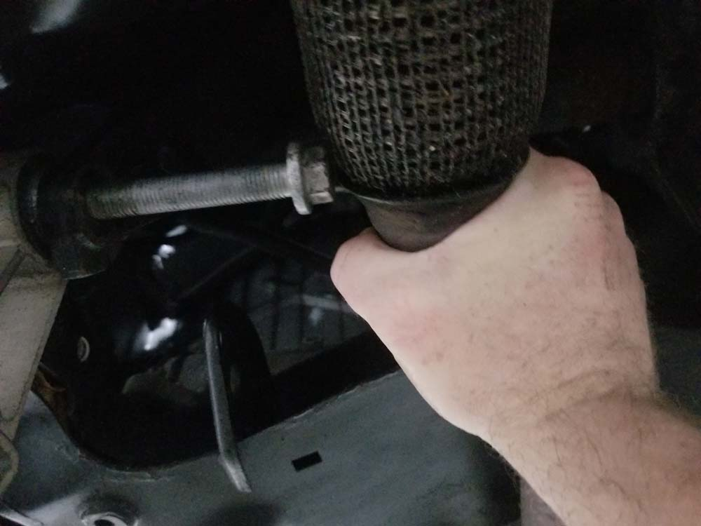 Push the exhaust pipe up with your hand to get clearance for the bolt
